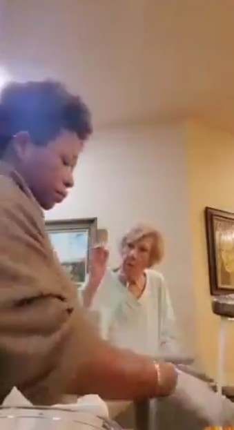 Racist old woman spits on black care giver